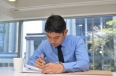 Businessman filling in a note