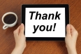 "Hands hold tablet PC with ""thank you"" text"